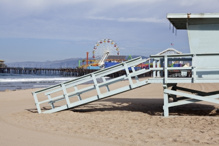 Famous Santa Monica beach, pier, and life guard tower in southern California.