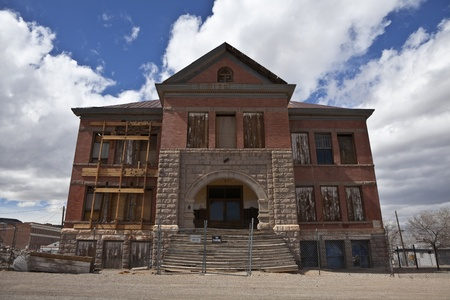 dilapidation: Goldfield, Nevada, USA - March 16, 2011:  Historic Goldfield High School ruin in Nevada