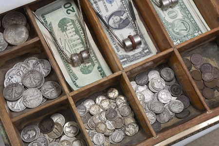Vintage money drawer with old US coins from the 1930s.