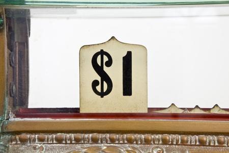 Vintage 1920's cash register pop up dollar sign detail. 免版税图像