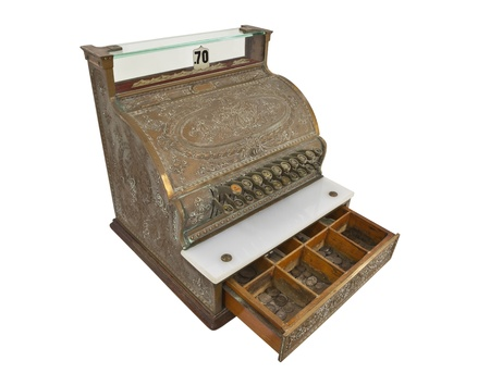 register: Vintage cash register and 1930s coins with money drawer open.