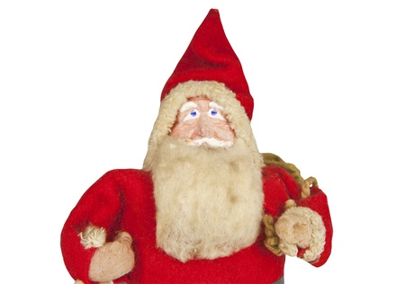 Antique Santa toy from the 1920s isolated on white. photo