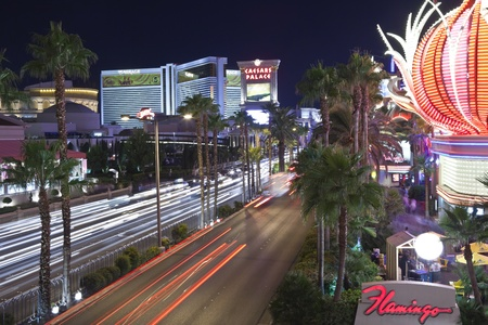 Las Vegas, Nevada, USA - October 21, 2011:  Night traffic at the Flamingo, Ceasars Palace and the Mirage resorts on the Las Vegas strip in southern Nevada. Stock Photo - 10950530