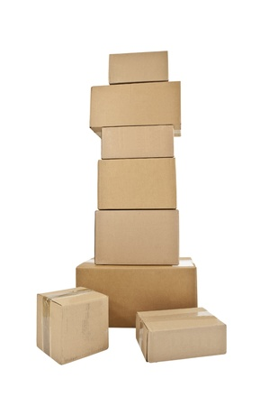 Tall stack of shipping boxes isolated on white.