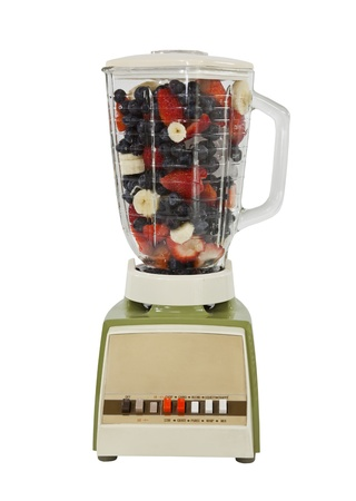 Berry banana smoothie mix in vintage blender, isolated on white. Stock Photo - 11747692