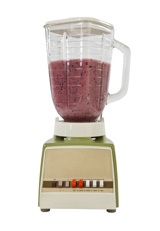 Berry banana smoothie in vintage blender, isolated on white. photo