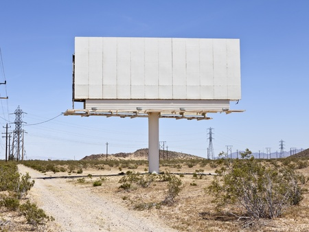 dirt road: Blank billboard in the middle of the Mojave desert. Stock Photo