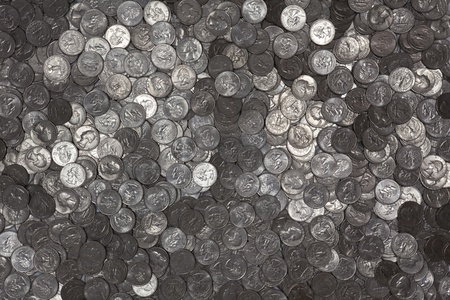 Reflective US Quarters background.  Newer States quarters are face up to avoid copyright concerns. photo