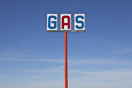 Tall vintage gas sign bight desert light. Stock Photo - 12428539