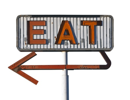 old sign: Vintage arrow eat sign isolated on white.   Stock Photo