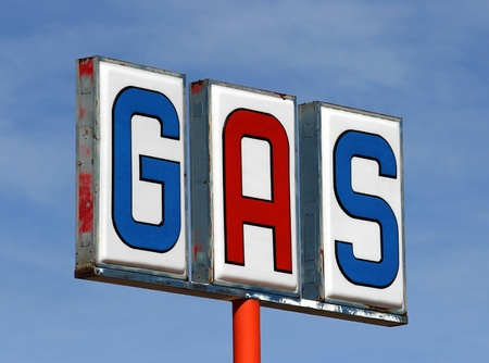 abandoned gas station: Old mojave desert gas sign at an abandoned service station  Stock Photo
