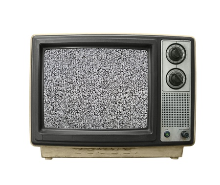 Beat up grungy old TV set with static screen. Stockfoto