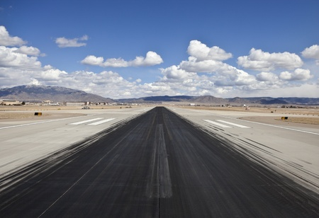 airplane landing: Heavy skid marks on a busy North American desert airport runway  Stock Photo