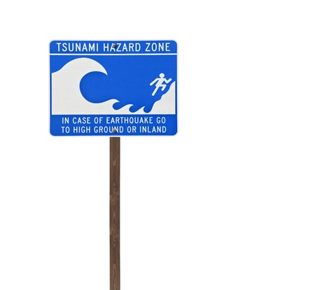 Tall isolated tsunami sign on a wooden post. photo