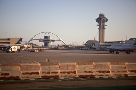 Los Angeles, California, USA - April,14, 2012:  LAX iconic theme building and control tower in warm sunset light.