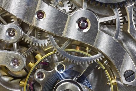 Antique pocket watch inside gears macro detail.  photo