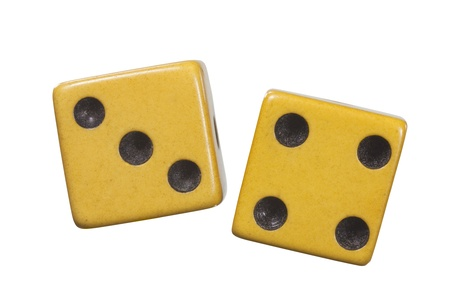 Antique dice with aged yellow patina macro isolated on white. photo
