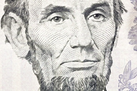 five dollar bill: Macro of Abe Lincoln on the US five dollar bill.