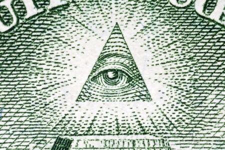 close up eye: Eye of Providence macro sul retro della banconota da un dollaro.