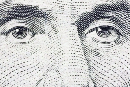 us currency: Extreme macro of Lincolns eyes on the US five dollar bill.