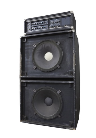 Grungy vintage bass amp with huge 15 inch speakers.  Thrashed from decades of heavy metal gigs. photo
