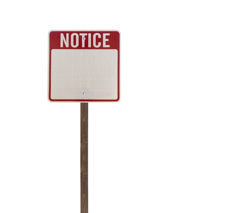 Tall isolated notice road sign on a wooden post. Stock Photo - 13706634