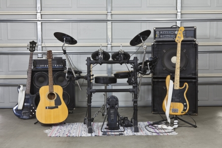 Rock band equipment in a suburban garage. Фото со стока