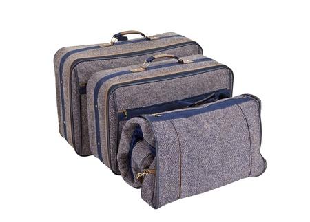 Vintage blue tweed suitcase set isolated.