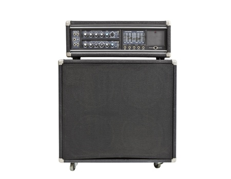 thrashed: Vintage rock and roll bass amplifier isolated on white. Stock Photo