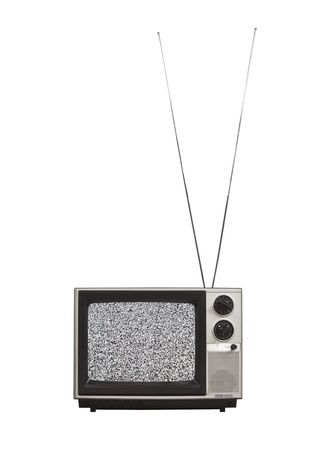 Static screen portable vintage television with long antennas up.  Isolated on white.