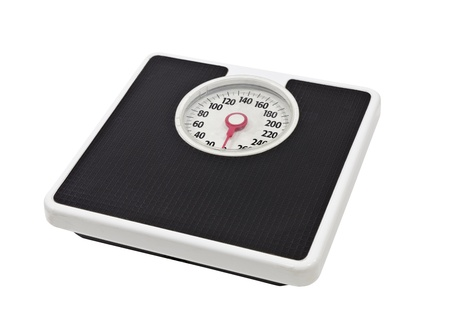 scale weight: Old, worn, bathroom scale isolated on white  Stock Photo