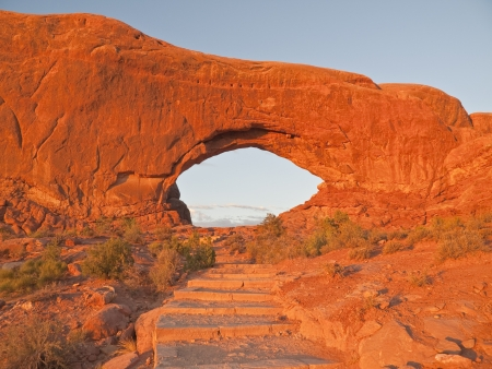 north window arch: Warm  sunset light on stairs to North Window Arch in Arches National Park
