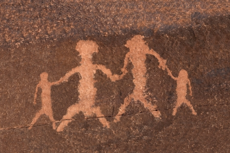 prehistoric man: Ancient petroglyph family depiction in Nevada Stock Photo