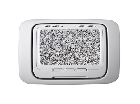 Airplane seat back television isolated with static screen.   Stock Photo - 14562585