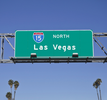 Las Vegas 15 Freeway sign with palm trees. Stock Photo - 14562554
