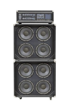 thrashed:  Vintage bass stack amplifier isolated on white.