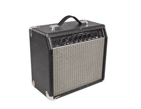 thrashed: Vintage guitar practice amplifier Stock Photo