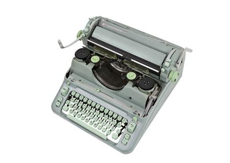 Vintage manual green metal typewriter isolated