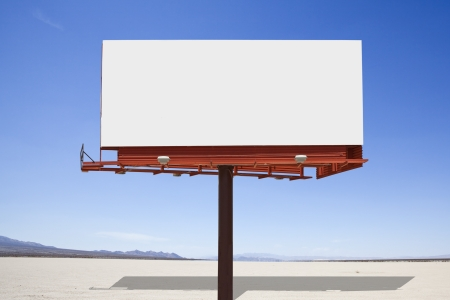 Big, blank billboard in the middle of a mojave desert dry lake Stock Photo - 15070967