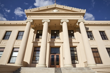 Warm afternoon light on County courthouse steps in rural central California. Stock Photo - 15054975