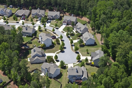 Modern comfortable middle class neighborhood aerial in the southeastern USA. Stock Photo