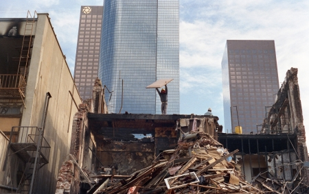 destruct: LOS ANGELES, CALIFORNIA - November 15, 1988: Workers demolish a historic building in the 300 block of Hill Street in downtown Los Angeles. Editorial