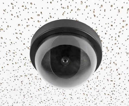 Security video surveillance camera globe on acoustic tile ceiling  Stock Photo - 15887458