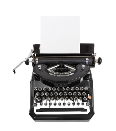 typewriter: Classic vintage black typewriter isolated with paper