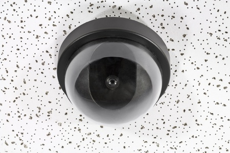 Overhead security camera globe on acoustic tile. Stock Photo - 16484980