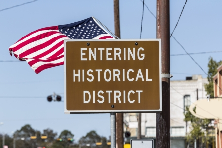 Entering historical district road sign with American Flag. Stock Photo - 16563047