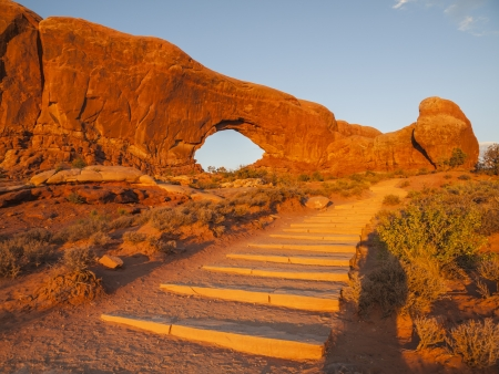 north window arch: North Window arch, trail and steps at sunset in Utahs Arches National Park. Stock Photo