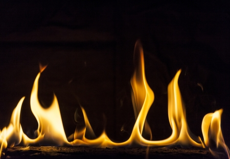 Flaming Log with black background. Stock Photo - 16790254