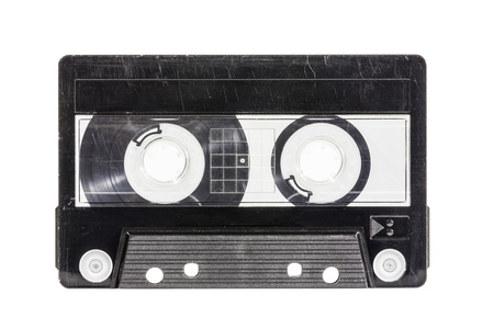 thrashed: Grungy old blank cassette tape isolated with clipping path. Stock Photo