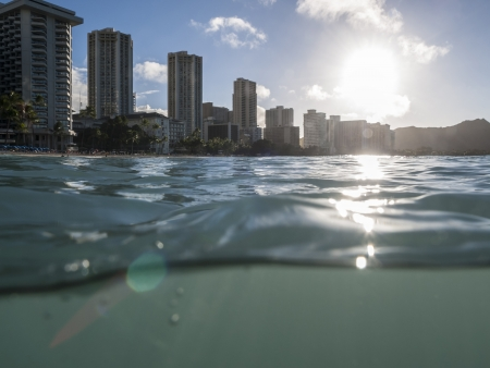 Partial underwater shot of Waikiki Haiwaii resorts and Diamond Head Peak shortly after sunrise.   Stock Photo - 16963760